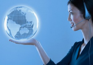 Woman with headset holding a globe --- Image by © Royalty-Free/Corbis